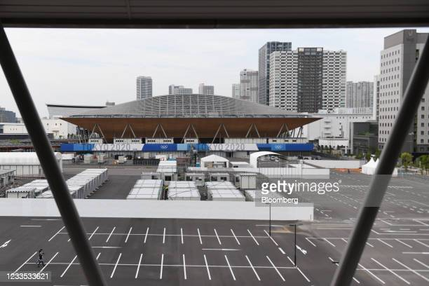 Parking lots in front of Ariake Gymnastics Centre, back, the venue for gymnastics events at the Tokyo 2020 Olympic Games in Tokyo Japan, on Friday,...
