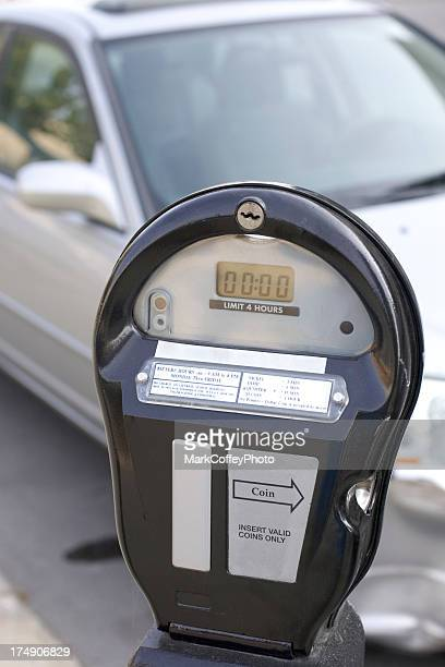 parking meter in front of a car - parking meter stock photos and pictures
