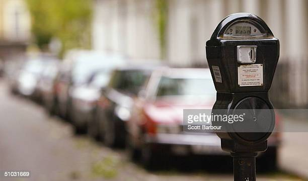 A parking meter is seen on a London street July 7 2004 in London England Money raised in England by parking fines meters residential parking schemes...