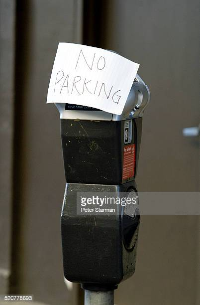 Parking meter with 'no parking' note