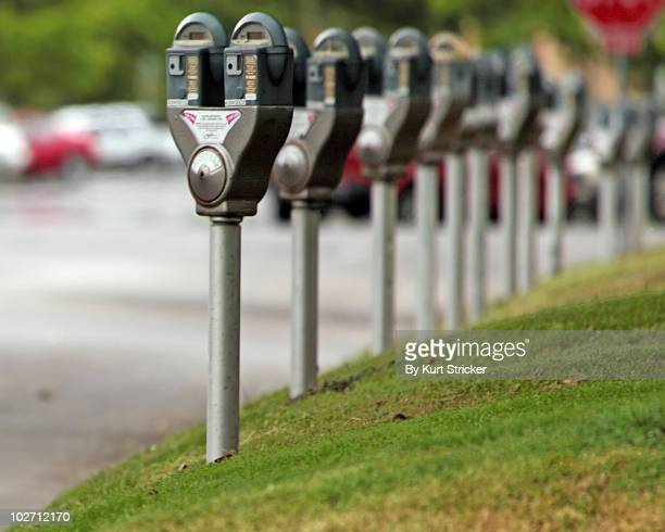parking meters with empty parking spaces - parking meter stock photos and pictures