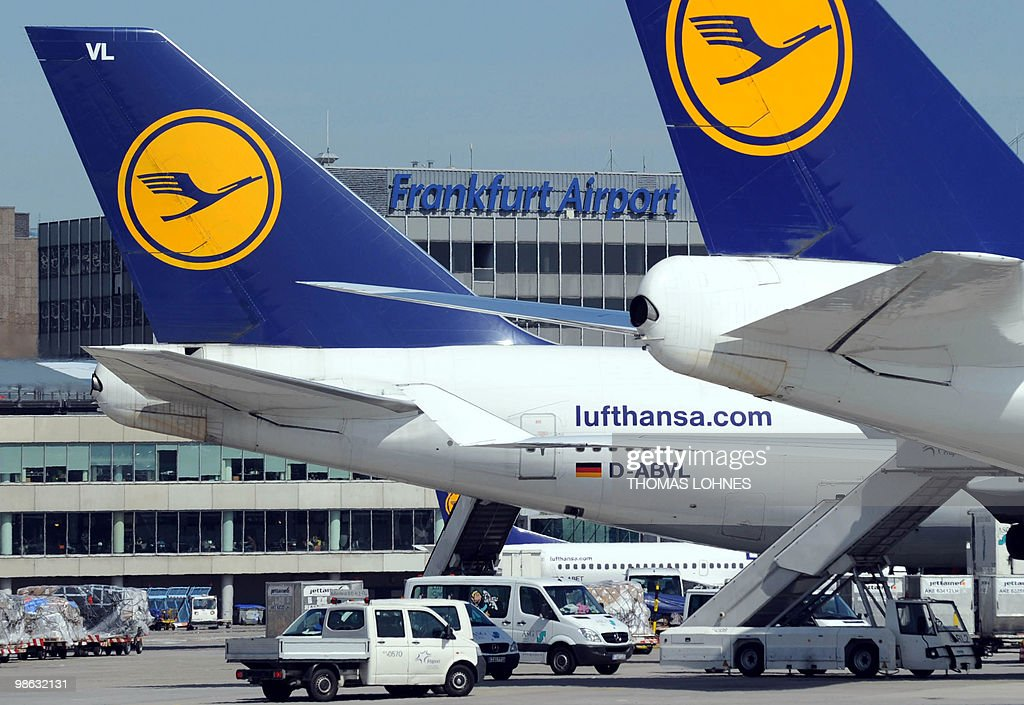 Parking planes are pictured from a new control tower at Frankfurt international airport on April 23, 2010 in Frankfurt am Main. The days of disruption caused by the volcanic ash cloud will dampen the German economy, Europe's largest, but should not harm the country's growth figures, Economy Minister Rainer Bruederle said the day before.