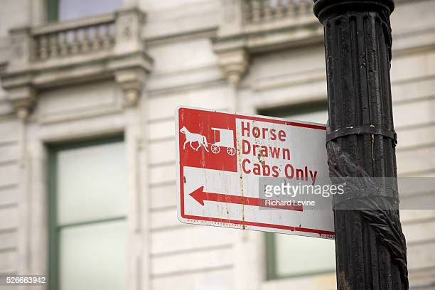 Parking regulation sign on Central Park South in New York of Friday, January 22, 2016 relegates the area to horse-drawn carriages. The New York City...