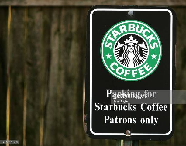A parking sign for Starbucks Coffee patrons only ouutside a Starbucks establishment October 3 2006 in Park Ridge Illinois Starbucks raised their...