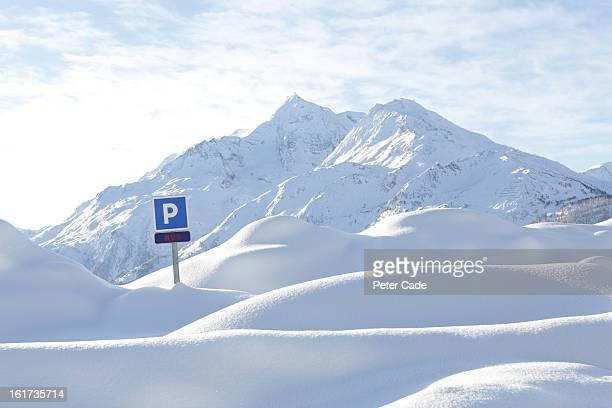 Parking sign in snowy scene