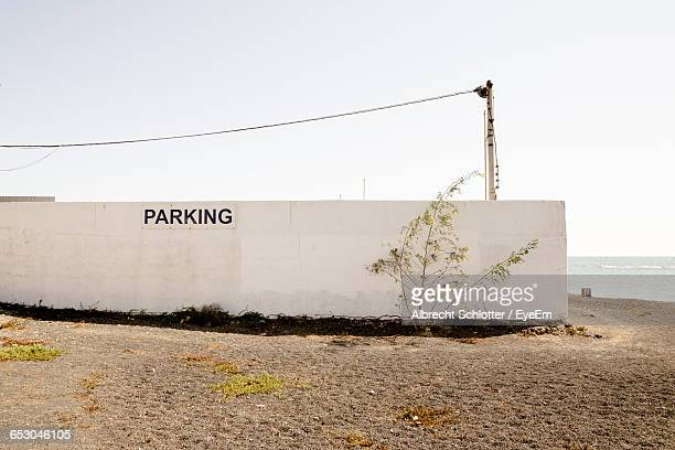 Parking Sign On Wall By Beach