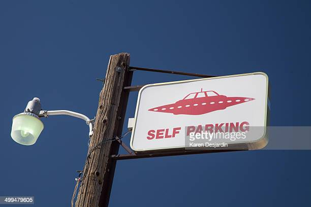 Parking sign with spaceship Rachel Nevada near Area 51 along Highway 385 also called the Extraterrestrial Highway