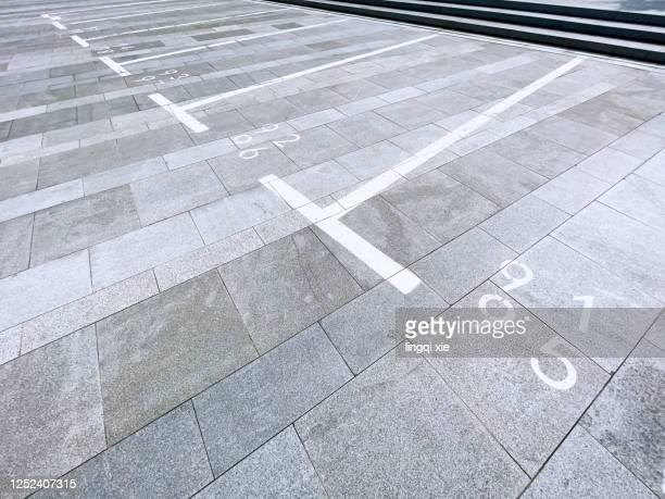 parking space sign on the ground of the parking lot - parkplatz stock-fotos und bilder