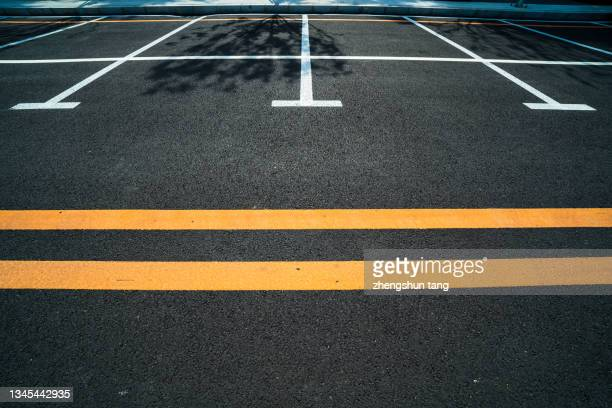 parking spaces marked with white lines - 中国北東部 ストックフォトと画像