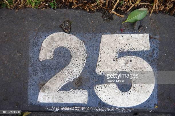 Parking spot number 25 stencilled in paint on the asphalt in Melbourne, Victoria, Australia