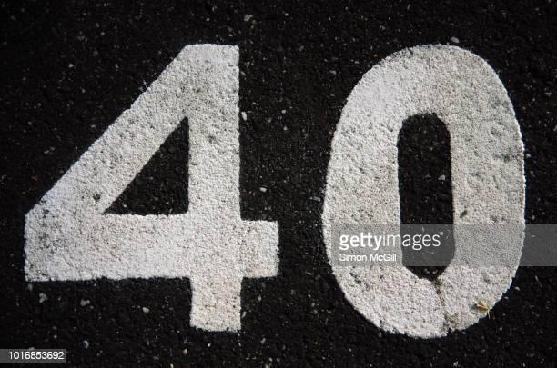parking spot number 40 stencilled in paint on the asphalt in melbourne, victoria, australia - 数字の40 ストックフォトと画像