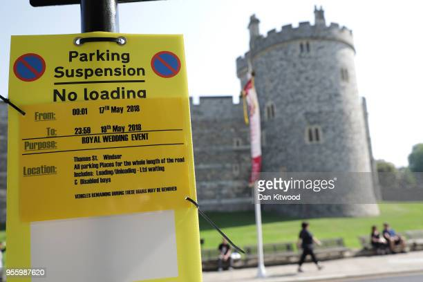 Parking suspension signs hang Windsor Castle as the town prepares for the wedding of Prince Harry and his fiance US actress Meghan Markle on May 8...