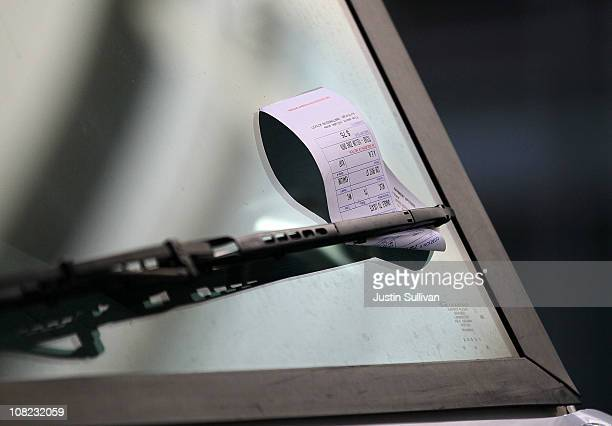 A parking ticket is seen on the windshield of a FedEx truck on January 21 2011 in San Francisco California In an effort to eliminate a projected $212...