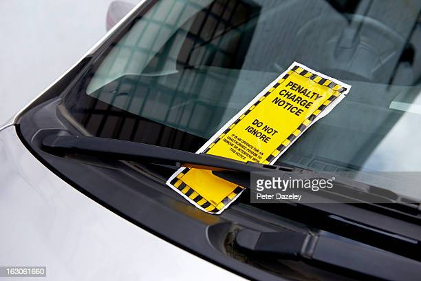 parking ticket on car windscreen - ticket stock pictures, royalty-free photos & images