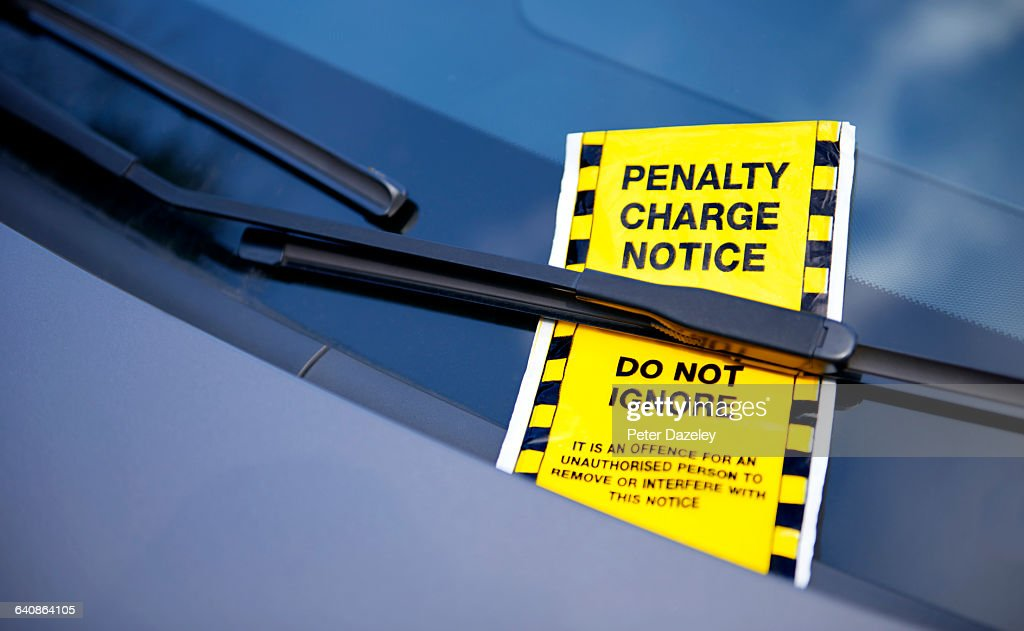 Parking ticket on windscreen : Stock Photo
