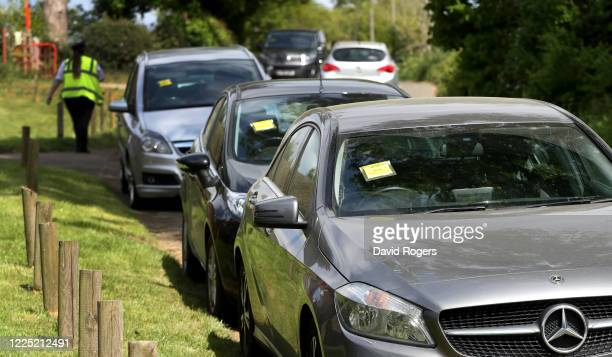 Parking tickets are issued to illegally parked cars near Sywell Country Park on May 16, 2020 in Northampton, United Kingdom. The prime minister...