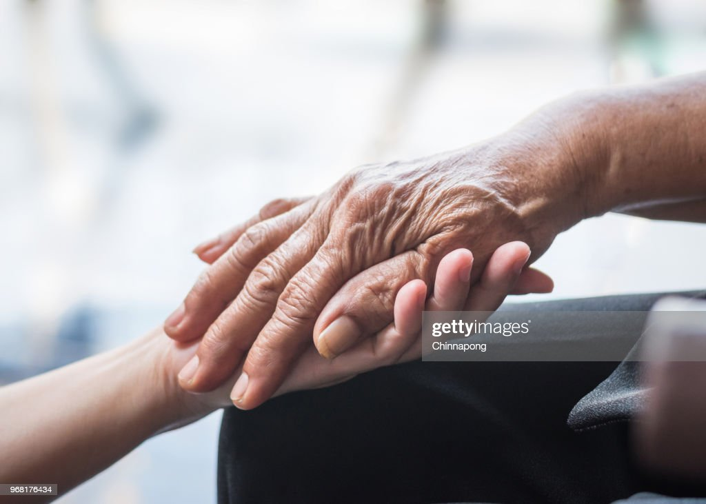 Parkinson disease patient, elderly senior person in support of nursing family caregiver for disability awareness day concept : Stock Photo
