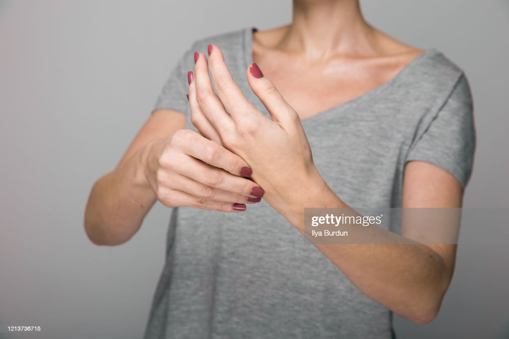 Parkinson's disease symptoms. Close up of tremor (shaking) hands of Middle-aged women patient with Parkinson's disease. Mental health and : Stock Photo