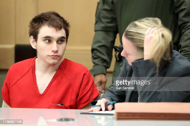 Parkland school shooter Nikolas Cruz speaks with Public Defender Melisa McNeill before a pretrial hearing at the Broward County Courthouse in Fort...