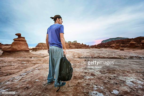 a parkour athlete outdoors on rock formations in the desert - robb reece stock photos and pictures