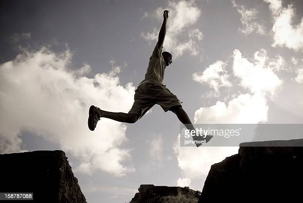 parkour free running man jumping against sky