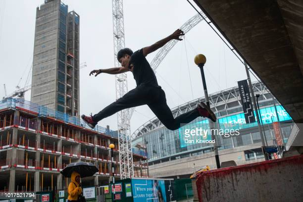 A parkour practitioner jumps onto a wall during a photocall to promote the 'International Parkour Gathering XIII 2018' at Wembley Stadium on August...