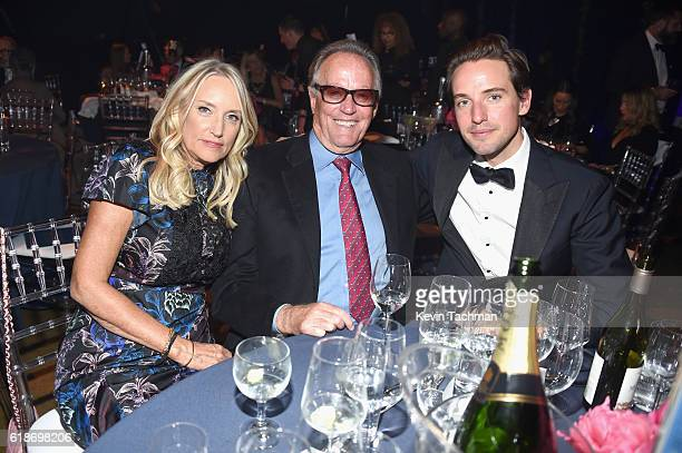 Parky Fonda actor Peter Fonda and auctioneer Alexander Gilkes attend amfAR's Inspiration Gala at Milk Studios on October 27 2016 in Hollywood...