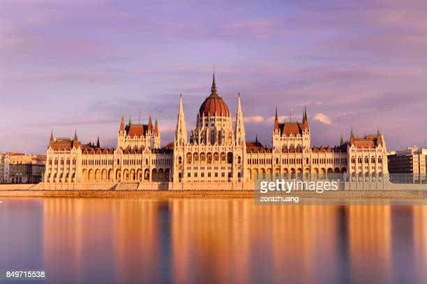 parliament building at sunset, budapest, hungary - budapest stock pictures, royalty-free photos & images