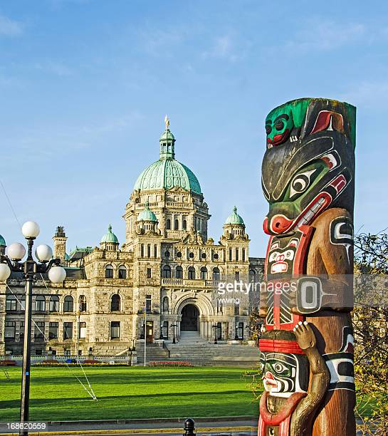 parliament building in victoria, british columbia - totem pole stock photos and pictures