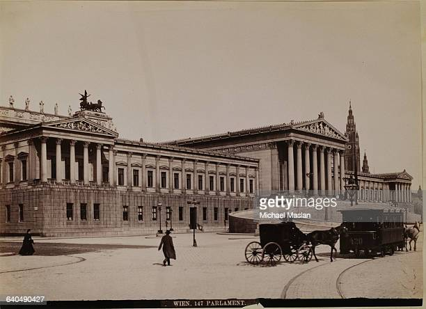 Parliament Building in Vienna Austria ca 1890 The building has neoclassical elements such as columns and pediments containing bas relief figures A...