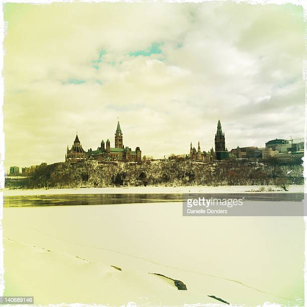 """parliament hill across snowy ottawa river - """"danielle donders"""" stock pictures, royalty-free photos & images"""