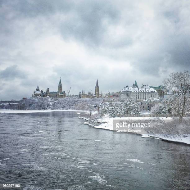 Parliament Hill across the icy Ottawa River in winter