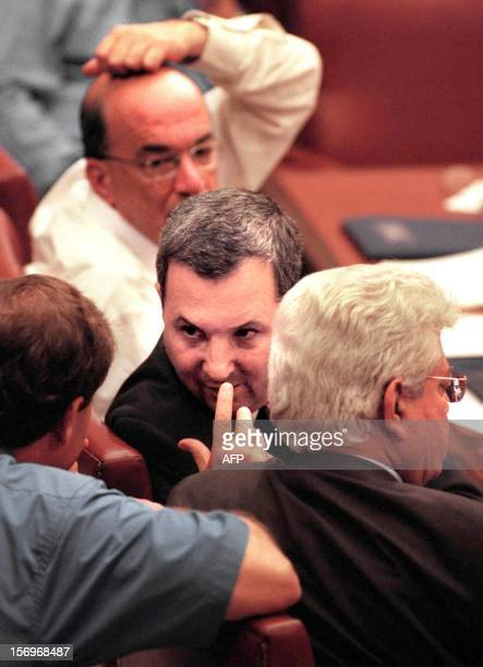 Parliament member Ofir Pines talk with Israeli Prime Minister Ehud Barak while Education Minister Yossi Sarid and Foreign Minister David Levy listen...