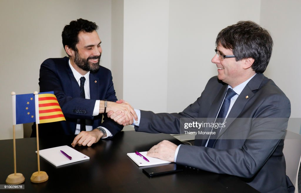Parliament of Catalonia Roger Torrent (L) and the ousted Catalan leader Carles Puigdemont (R) pose as they meet on January 24, 2018 in Brussels, Belgium.