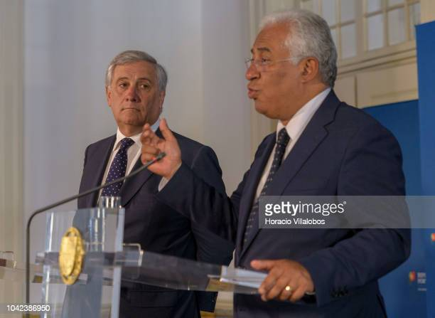 Parliament President Antonio Tajani listens to Portugal's Prime Minister Antonio Costa delivering remarks during the press conference held at the end...