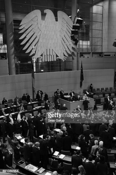 Parliamentarians at the Bundestag cast their ballots while voting to extend one of several German foreign military missions on December 12 2017 in...