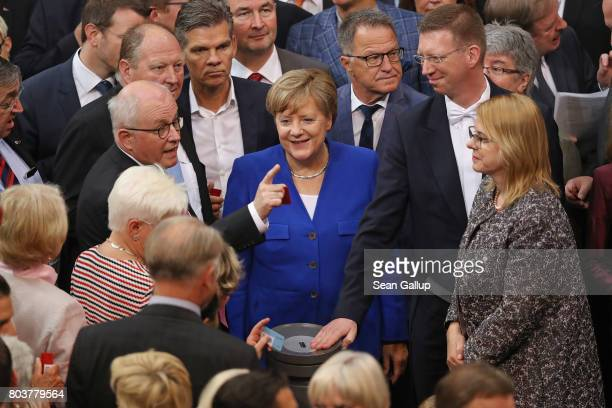 Parliamentarians including German Chancellor Angela Merkel and head of the Bundestag faction of the German Christian Democrats Volker Kauder prepare...