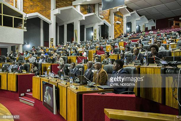 Parliamentarians listen to lawmaker Eugene Barikana speak during a debate on different articles to be changed in the constitution on October 29 at...