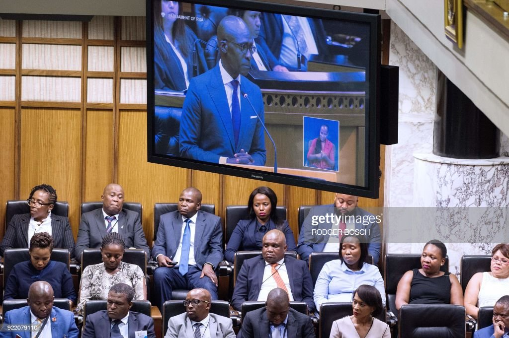 Parliamentarien listen to South African Finance Minister Malusi Gigaba as he delivers the 2018 Budget speech in the National Assembly at the South African Parliament, on February 21, 2018, in Cape Town. /