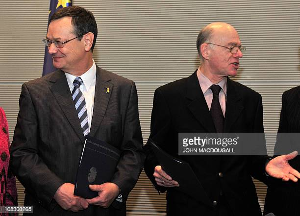 Parliamentary commissioner for the armed forces Hellmut Koenigshaus and President of the Lower House of Parliament Norbert Lammert chat after...