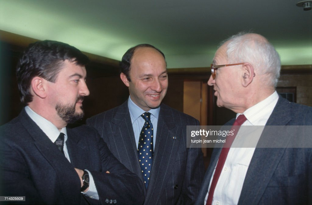 Parliamentary days of the Socialist Party in Paris, 27th March 1990. From left to right : Jean-Luc Mélenchon, Laurent Fabius and Jean Poperen