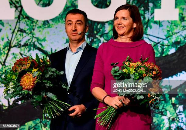 Parliamentary group coleader of the Green party Katrin GoeringEckardt and coleader of the Green party Cem Ozdemir hold their bouquets during an...
