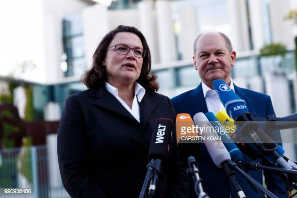 Parliamentary group leader of the Social Democratic Party Andrea Nahles and German Finance Minister and Vice-Chancellor Olaf Scholz speak to...