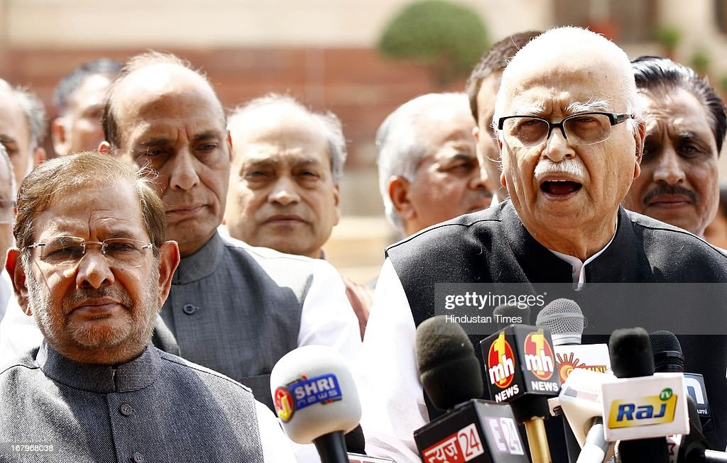 BJP Parliamentary Party Chief LK Advani, JD (U) Chief Sharad Yadav and BJP President Rajnath Singh talking to the media person after meeting with President Pranab Mukherjee at the forecourt of Rashtrapati Bhawan on May 3, 2013 in New Delhi, India. MPs of BJP-led NDA today met President Pranab Mukherjee to express concern over Chinese incursions into Ladakh and the manner in which the case of Indian prisoner Sarabjit Singh was handled by the government.