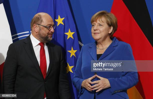 Parliament's President Martin Schulz and Germany's Chancellor Angela Merkel arrive in the plenary room of the EU Parliament on October 7 2015 in...