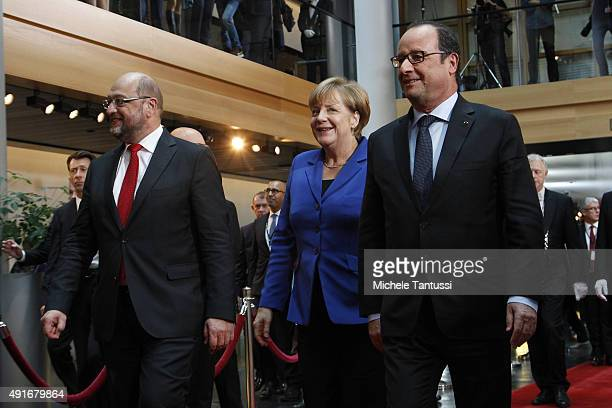 Parliament's President Martin Schulz, Germany's Chancellor Angela Merkel and French president Francois Hollande arrive ahead of their joint speech to...