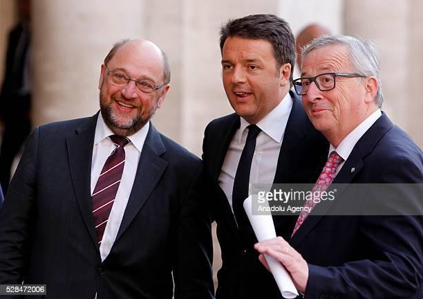 EU Parliament's speaker Martin Schulz Italian Prime Minister Matteo Renzi and EU Commission president JeanClaude Juncker greet media as they arrive...