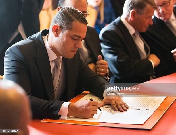 Parlimentary President of Aruba Paul Croes signs the Act of Abdication of Queen Beatrix of the Netherlands in the Moseszaal at the Royal Palace on...