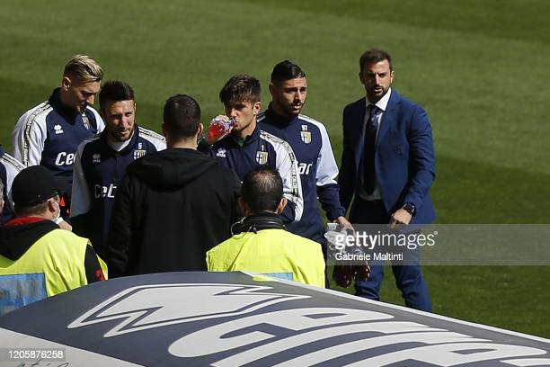 Parma Calcio and Spal players return to the locker room the game has been postponed for 30 minutes ahead of the Serie A match between Parma Calcio...