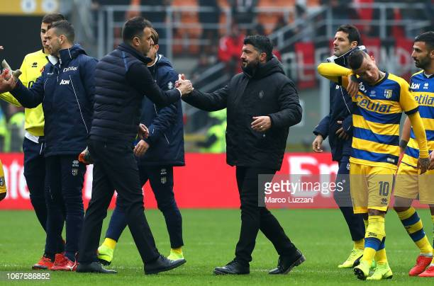 Parma Calcio coach Roberto D Aversa shakes hands with AC Milan coach Gennaro Gattuso at the end of the Serie A match between AC Milan and Parma...